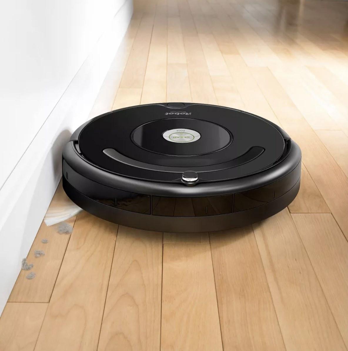the roomba vacuum cleaning hardwood floors