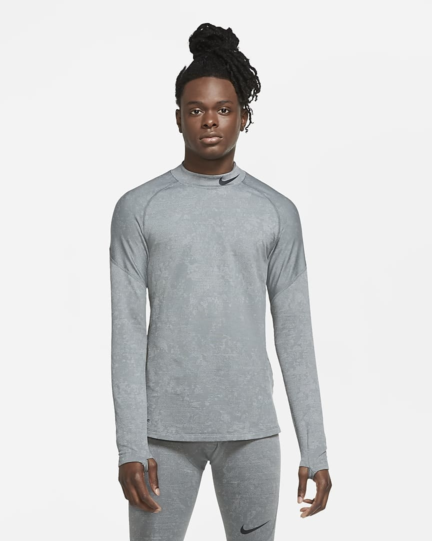 Model wearing the long-sleeved shirt with thumb holes in grey
