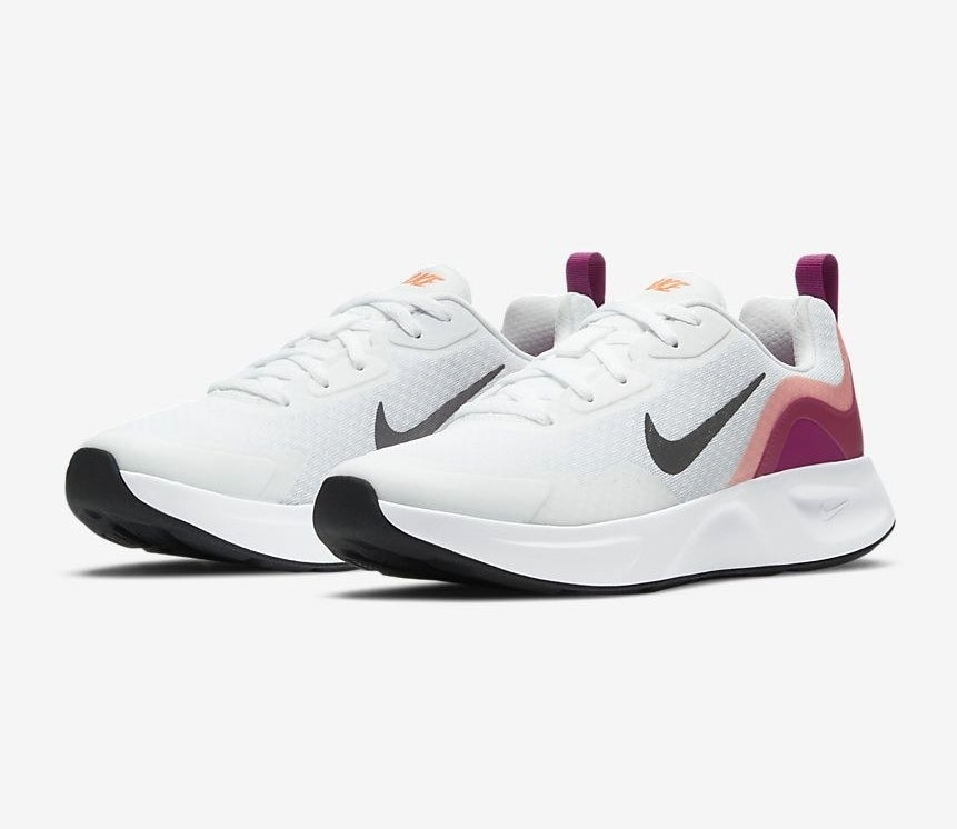 The sneakers in white with accents of magenta and light pink