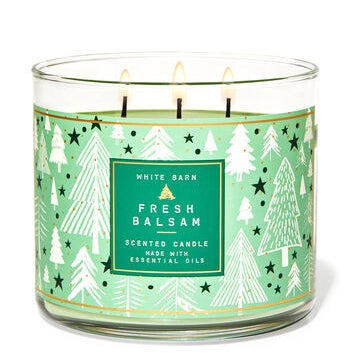 """a glass candle with a tree label on it and the words """"fresh balsam"""""""