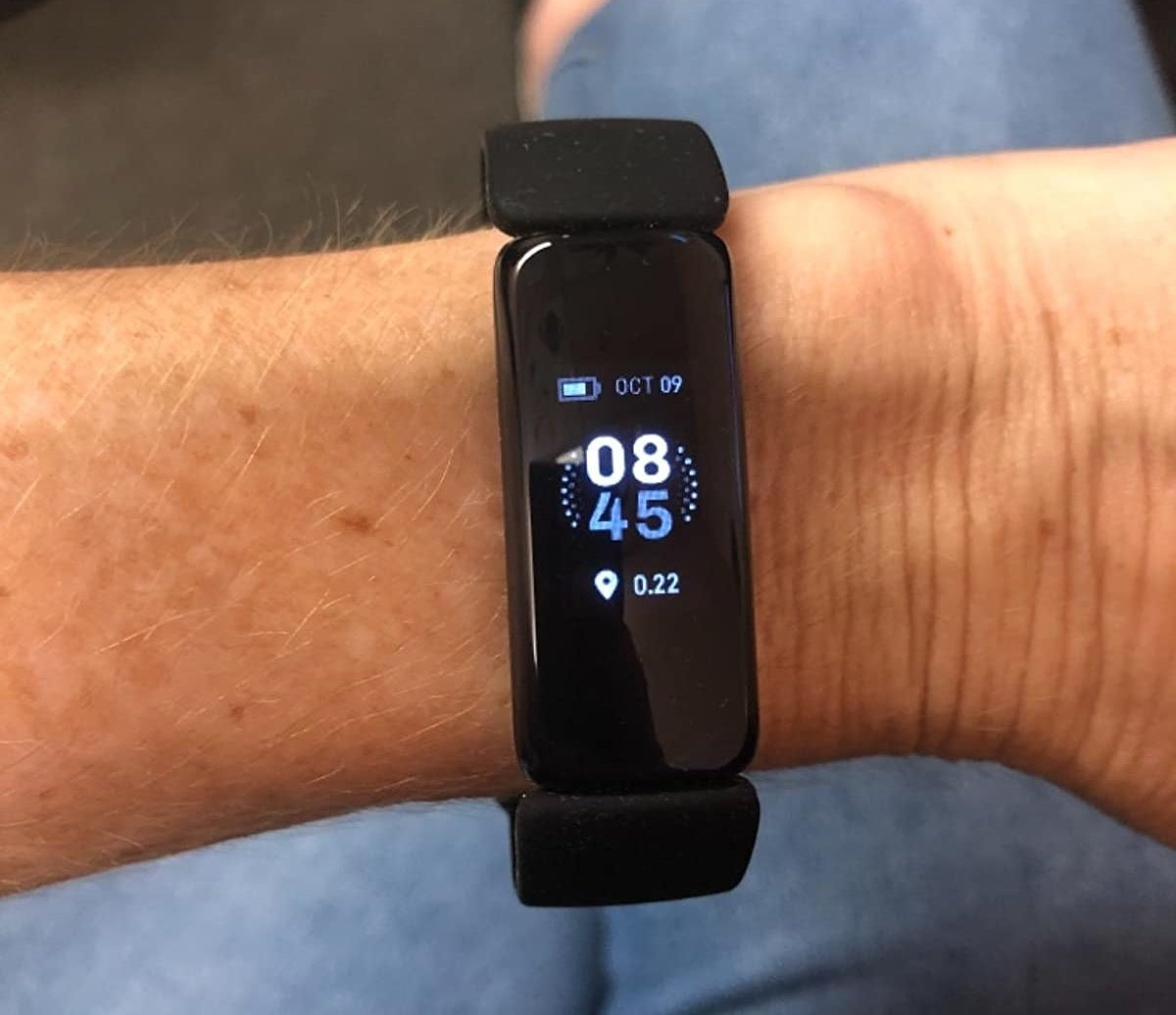 Reviewer wearing Fitbit Inspire 2 fitness tracker on their wrist