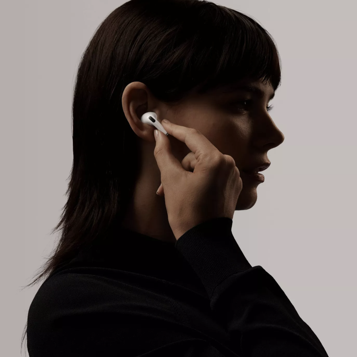 Model inserted Apple AirPod Pro into her ear