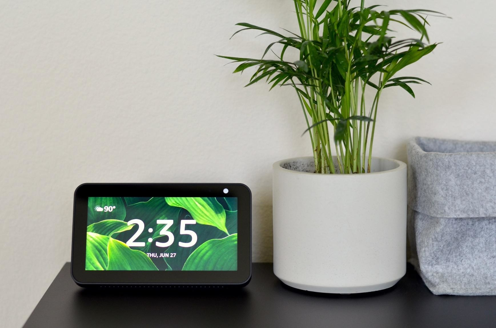 Amazon Echo Show 5 on table next to plant