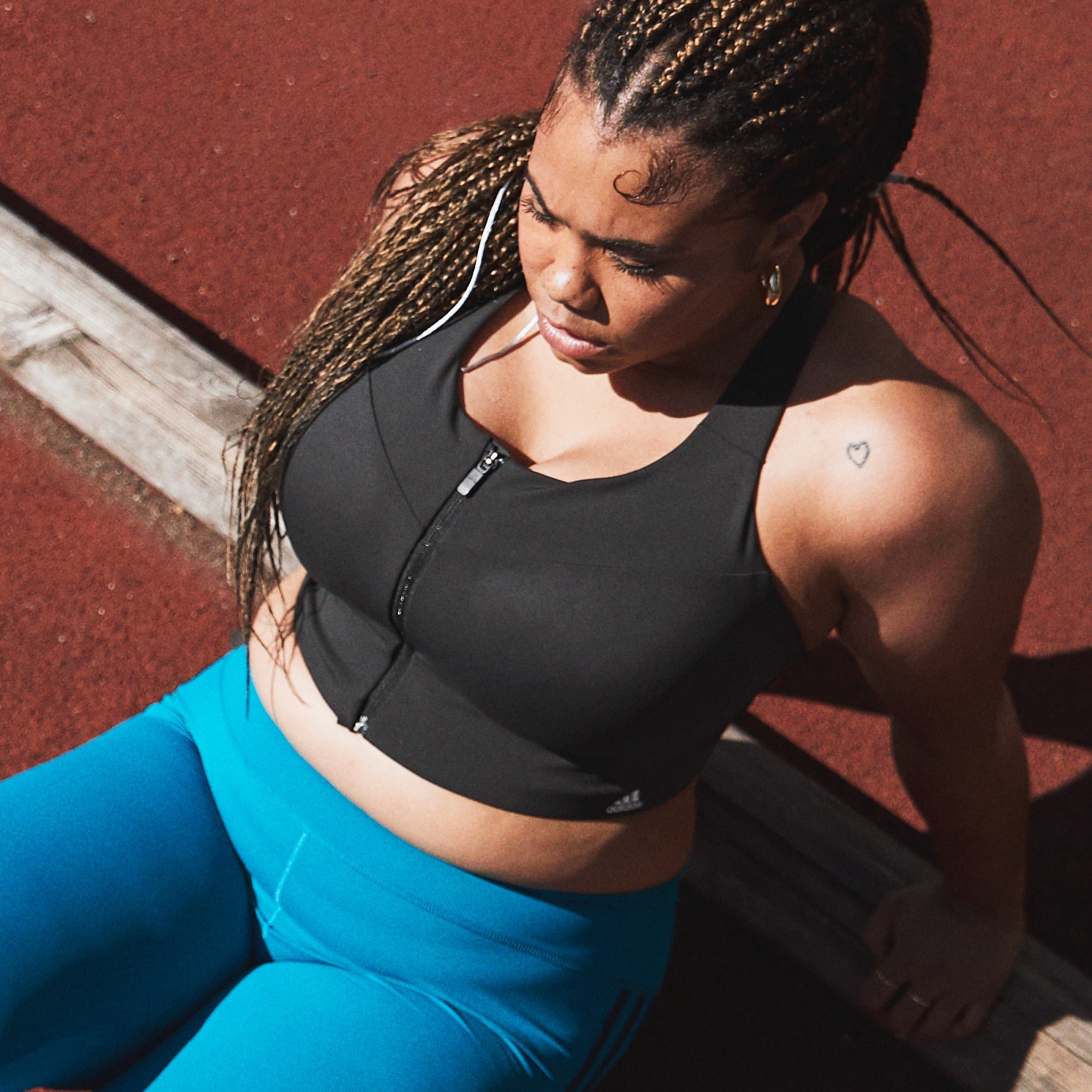 A person wearing a cropped sports bra.
