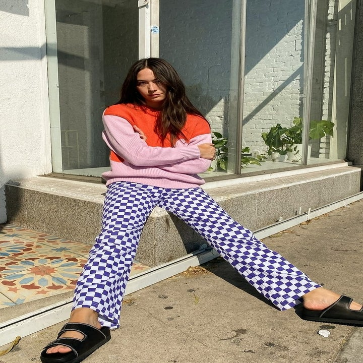 Model wearing blue and white checkerboard pants