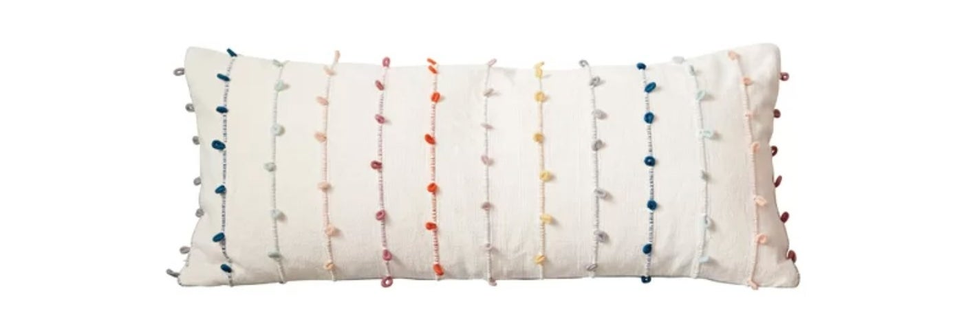 The rectangular pillow with colorful embellishments