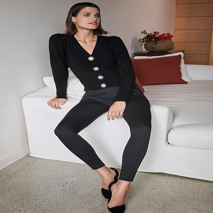 model wearing the pants, showing the satin-y sheen effect