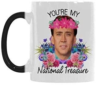 "coffee mug with Nic Cage's face on it with flowers and the words ""You're my national treasure"""