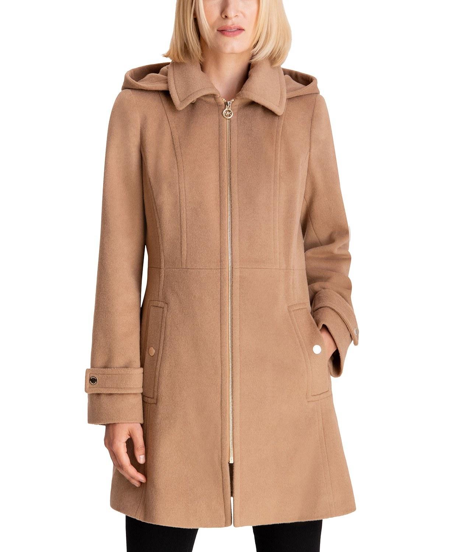 model wearing Michael Kors hooded coat in dark camel