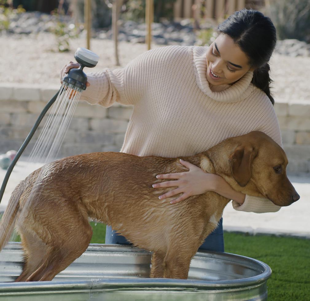 Oxygenics PawSpa pet washer being used on dog