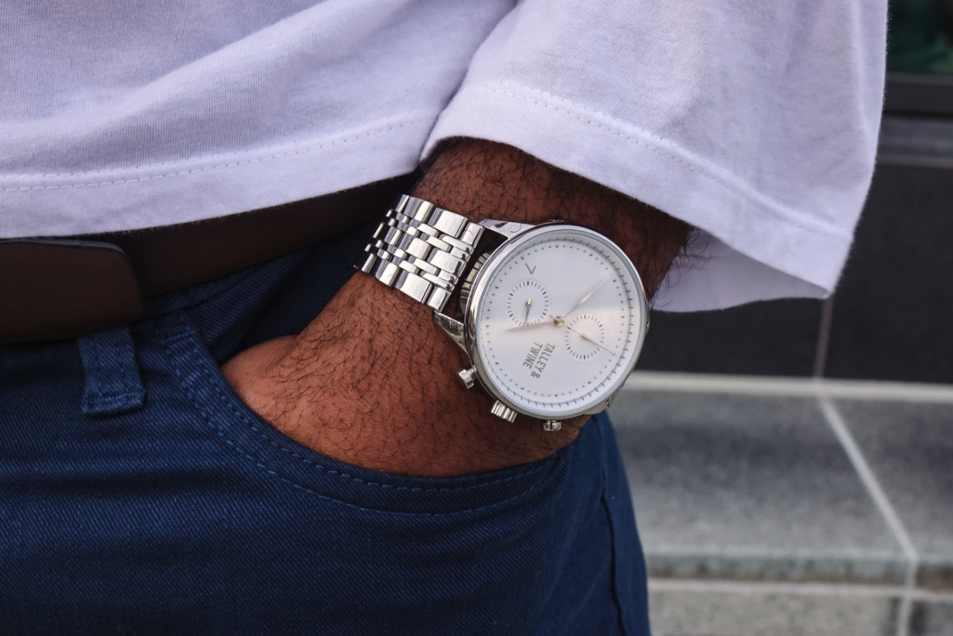 The watch in silver on a wrist