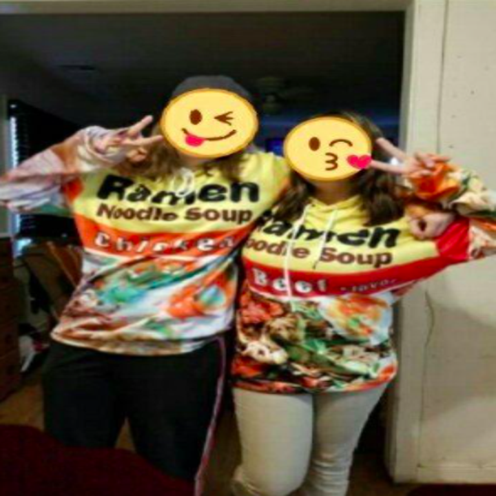 two reviewers wearing the chicken and beef ramen hoodies