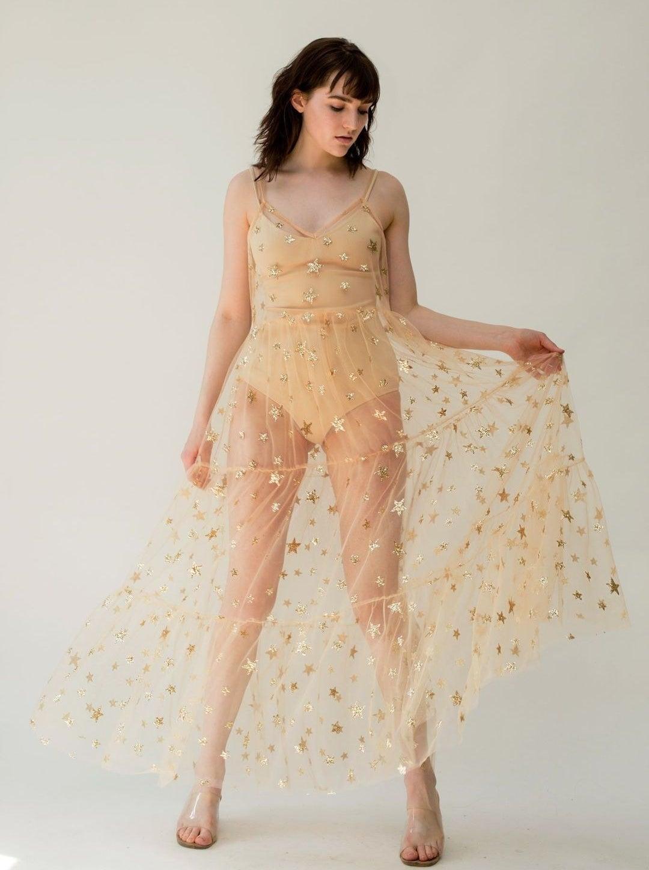 model wearing the gold mesh dress