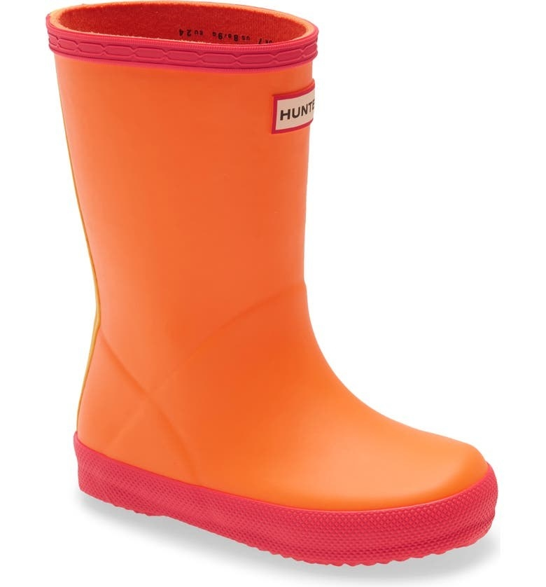 the boots in orange with red-colored grips