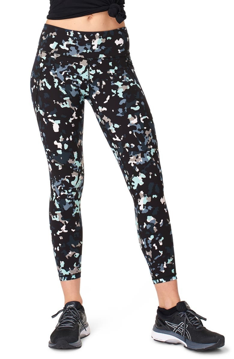 a black pair of leggings with speckled coloring