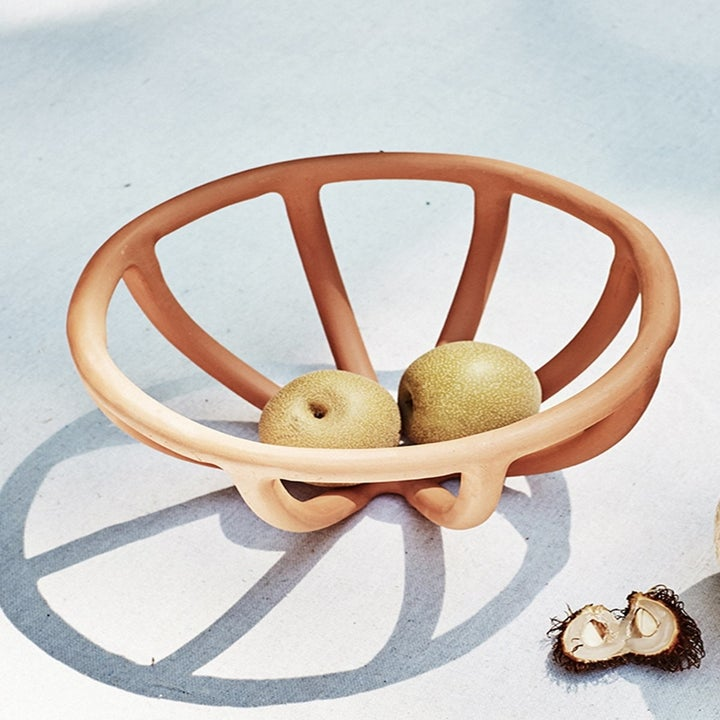 A terracotta open fruit bowl