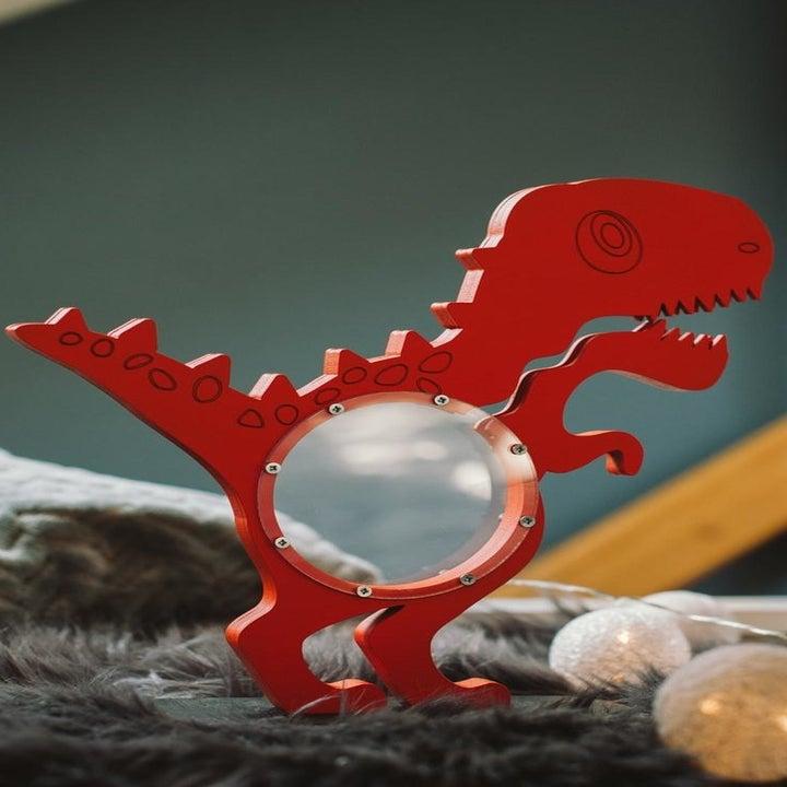 dinosaur piggy bank in red
