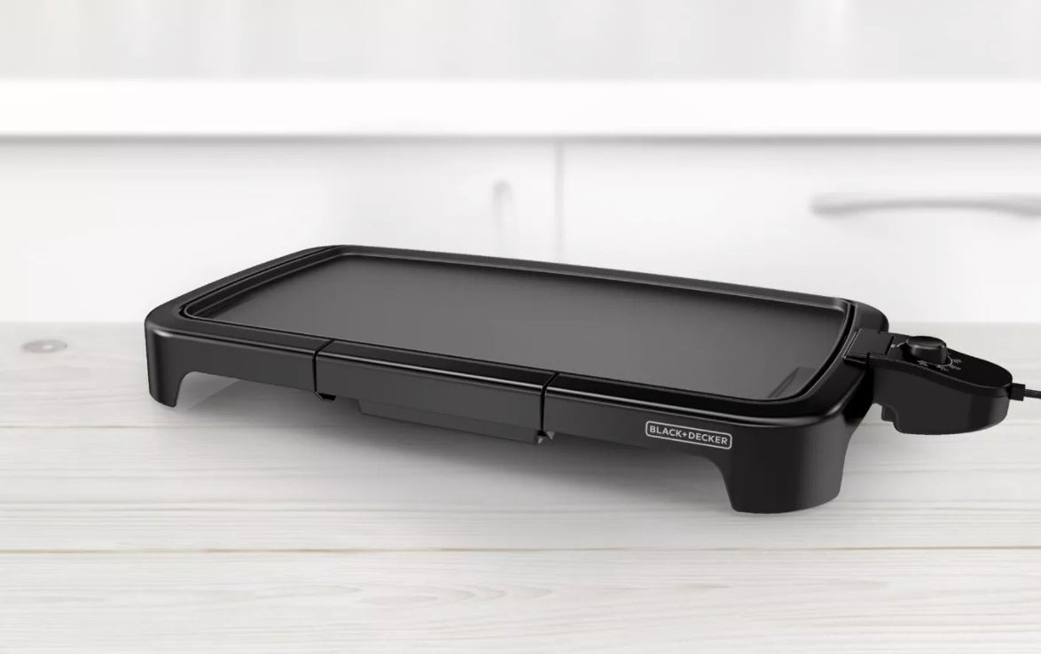 the electric griddle on top of a silver wood counter