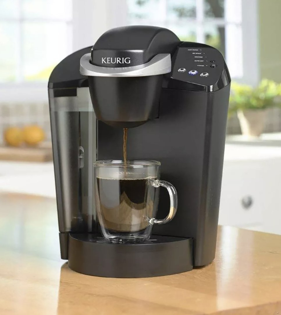 the keurig brewing a fresh cup off coffee into a glass cup