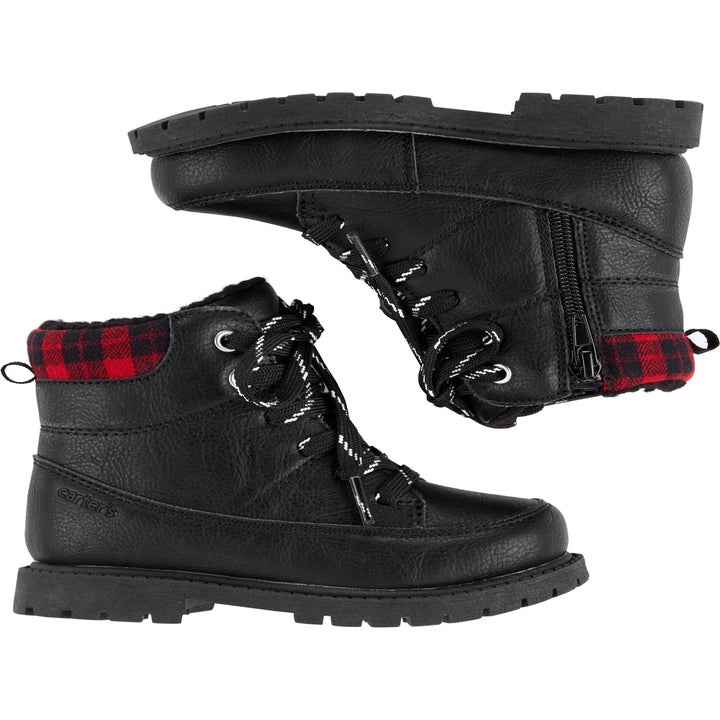 Black high top boots with red plaid on the top