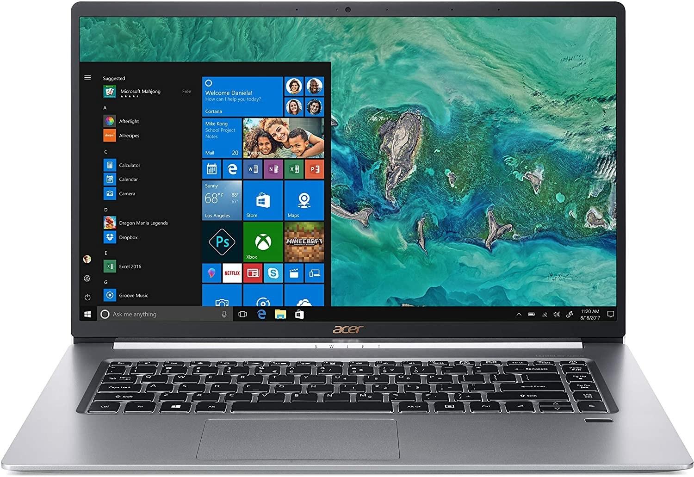 An open laptop on a plain background