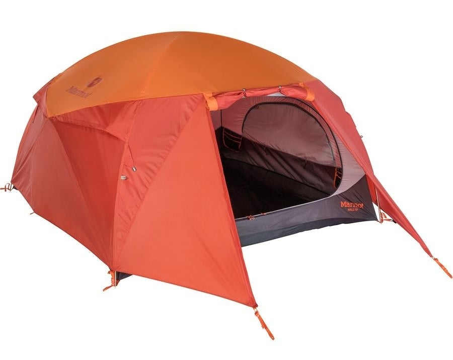 orange and red domed tent with a large zippered door and staked vestibule