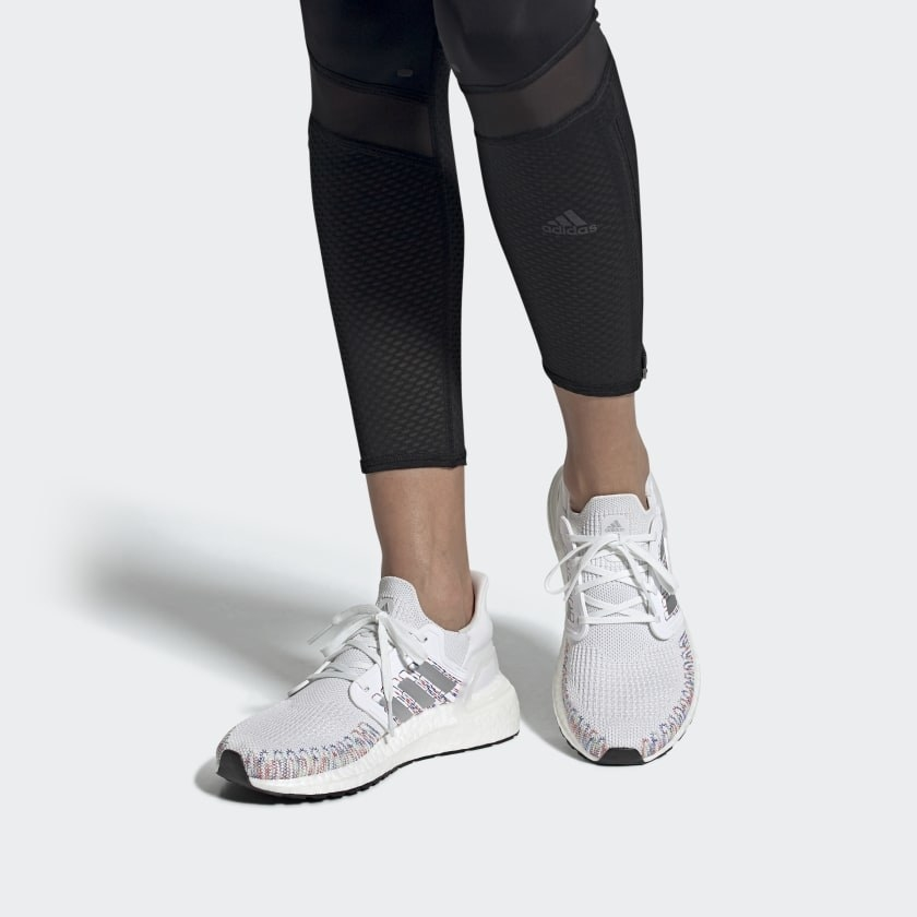 A person wears a pair of running shoes