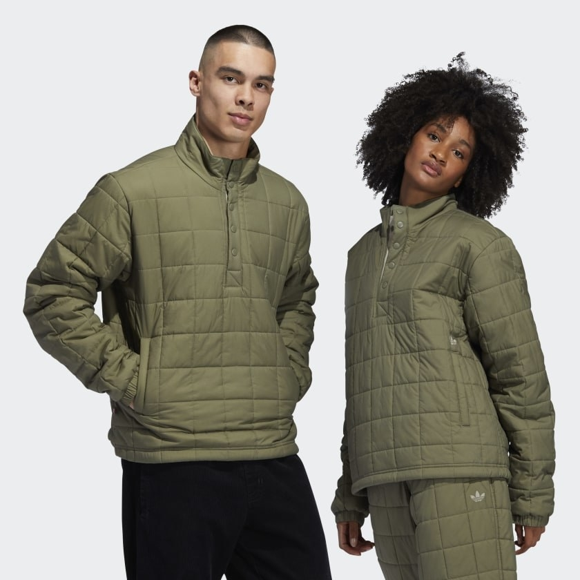 Two people wear the same jacket