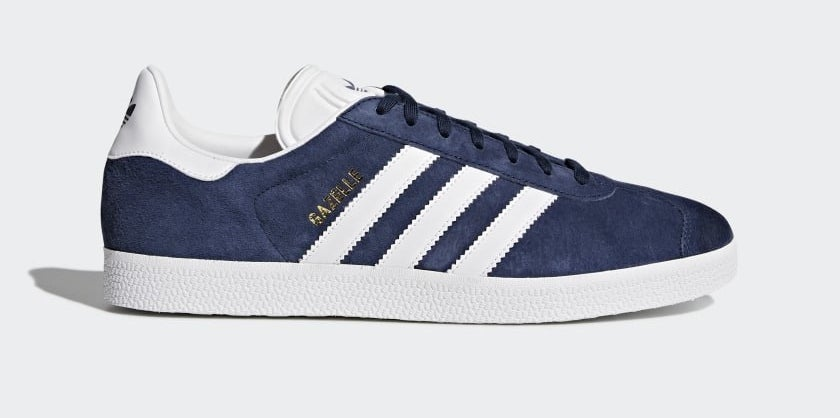 A shoe with the Adidas stripes along the side