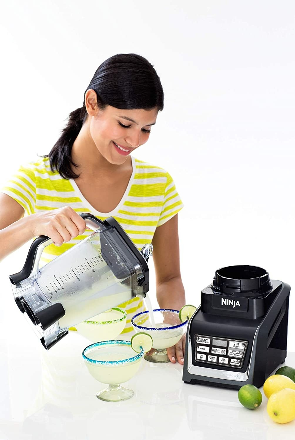 woman pouring out margaritas with the Ninja blender