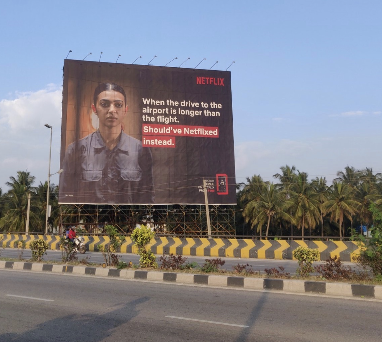 Signboard of Netflix ad on highway saying 'When the drive to the airport is longer than the flight'