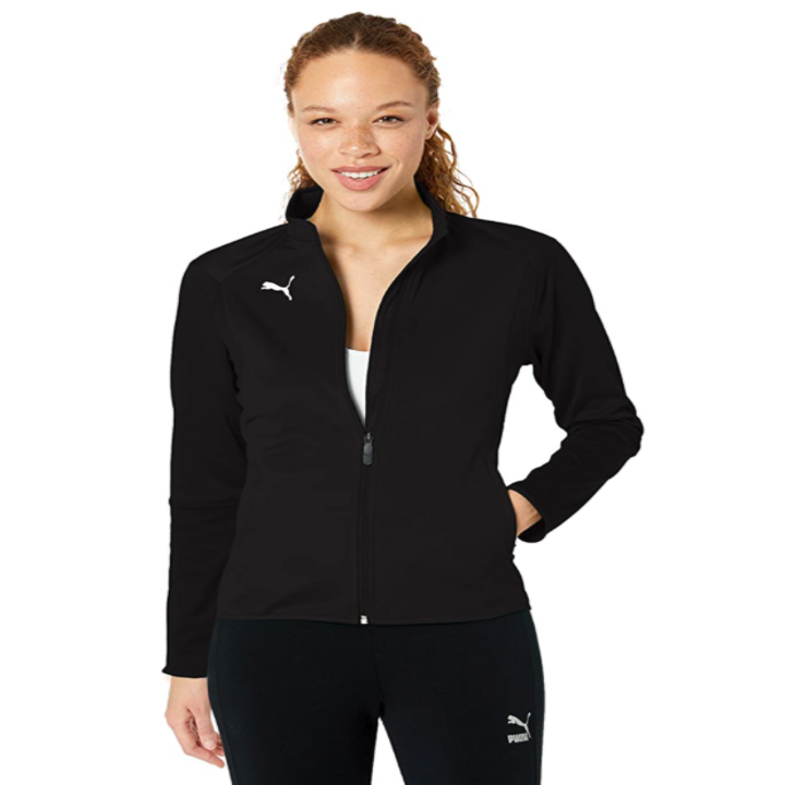 model wearing a black training zip-up jacket with a white puma logo