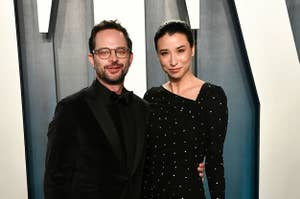 Nick Kroll and Lily Kwong posing together at the Vanity Fair Oscars party