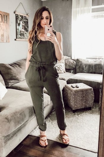Reviewer wearing the olive jumpsuit