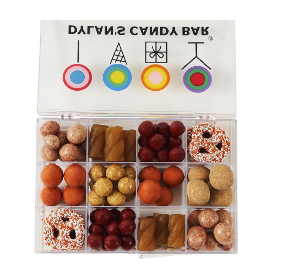 lidded plastic box with 12 compartments with different candy