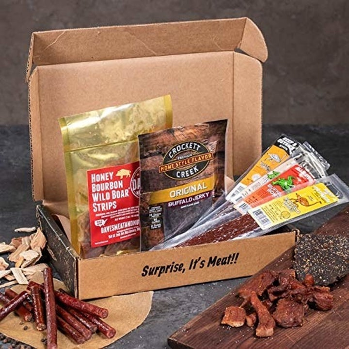 An open cardboard box filled with packets of jerky