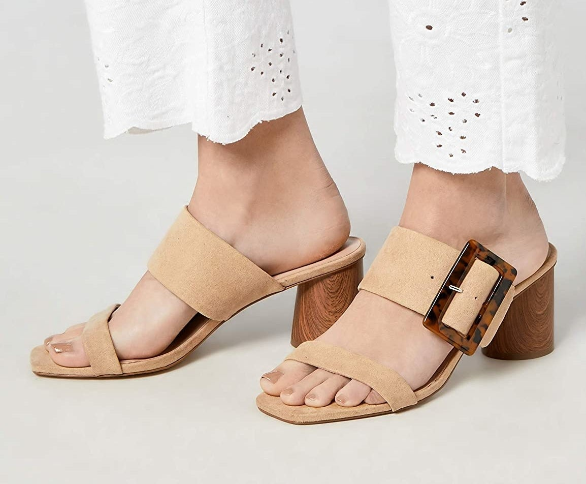 The tan sandals with a thin toe strap and a thicker foot strap and tortoiseshell square buckle