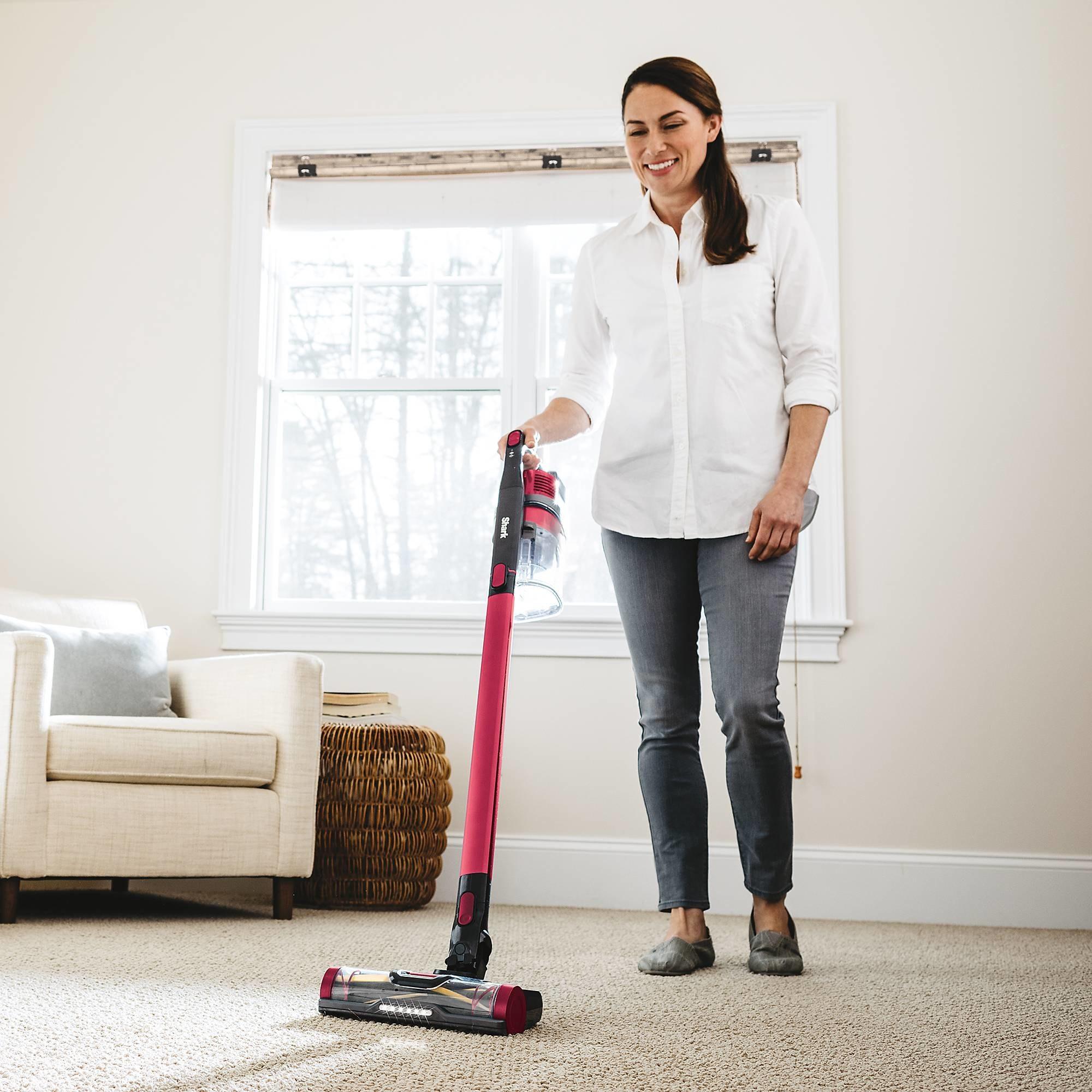 person using the vacuum