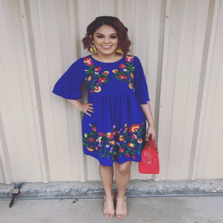 A different reviewer wearing the dress in blue