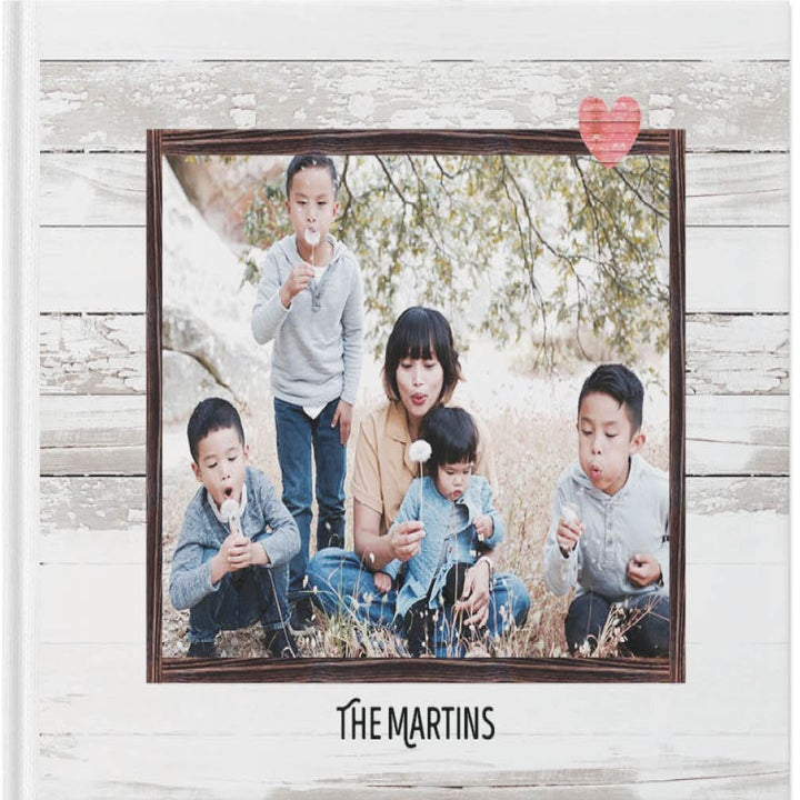 """A photo album cover with text that reads """"The Martins"""""""