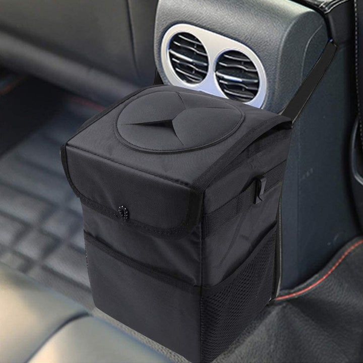 Same trash can with lid covering, attached to center console in back of car