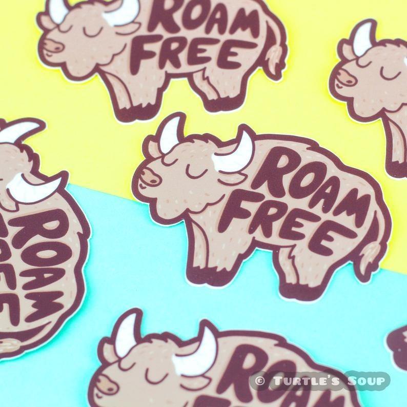 "buffalo shape sticker that says ""roam free"""