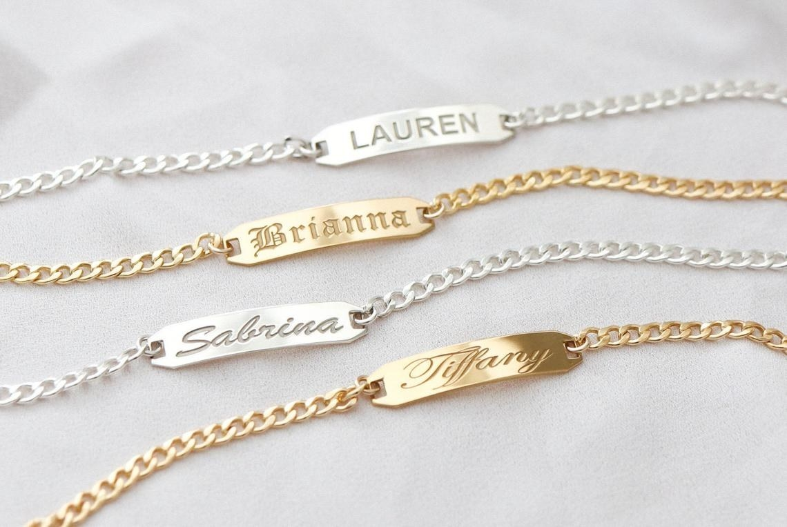 Four chain bracelets with names engraved on a solid bar