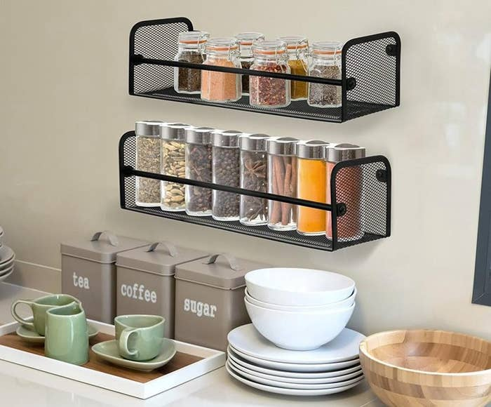 The mounted spice racks in use