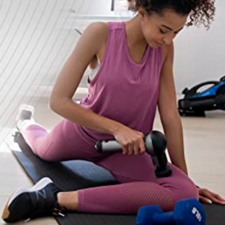 Person using massager on leg