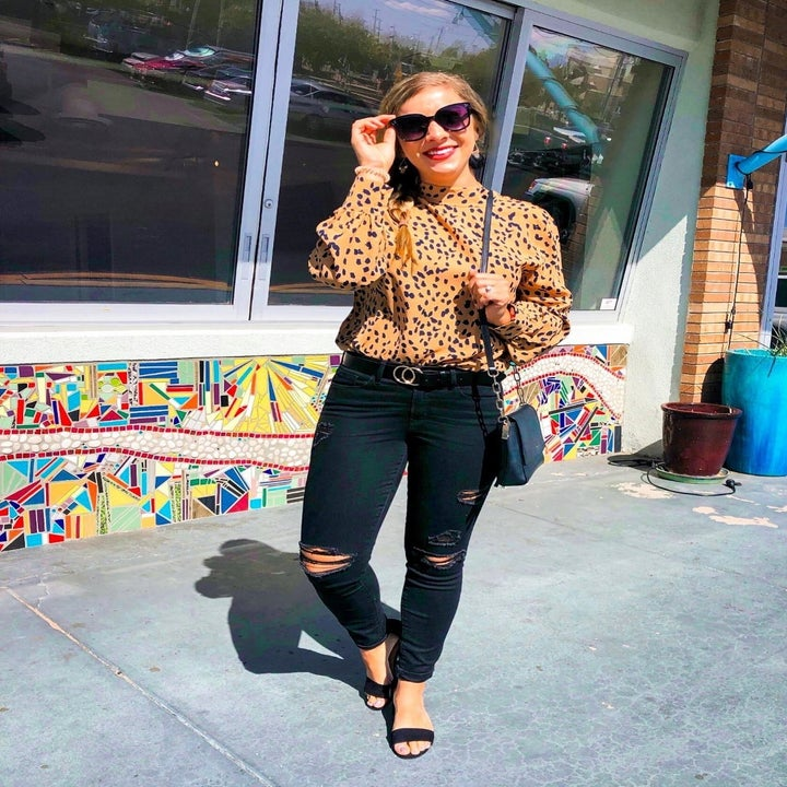 Reviewer wearing the leopard print blouse in tan