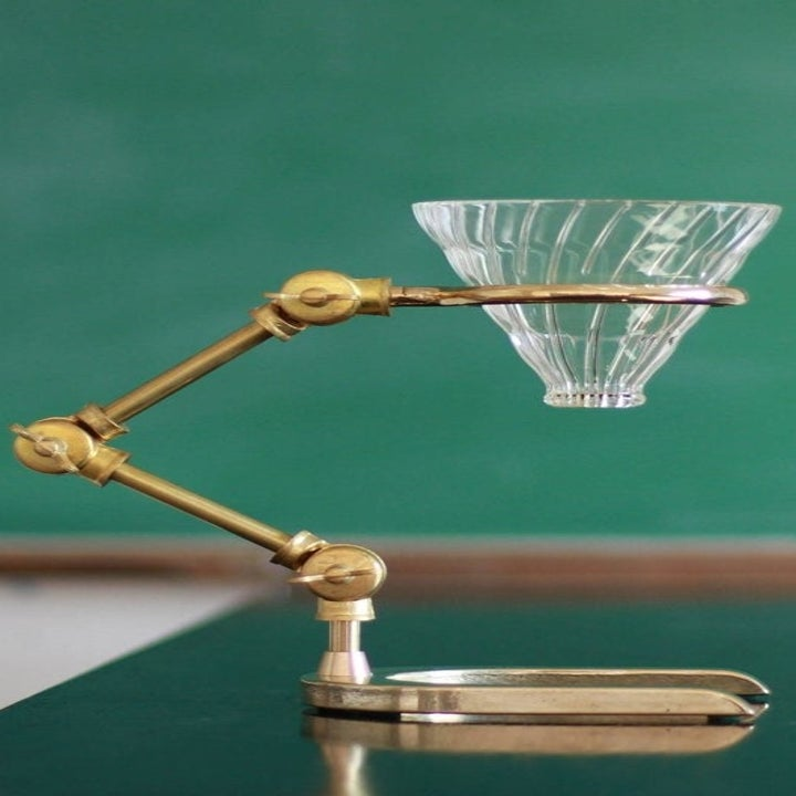 A brass stand with a crystal funnel