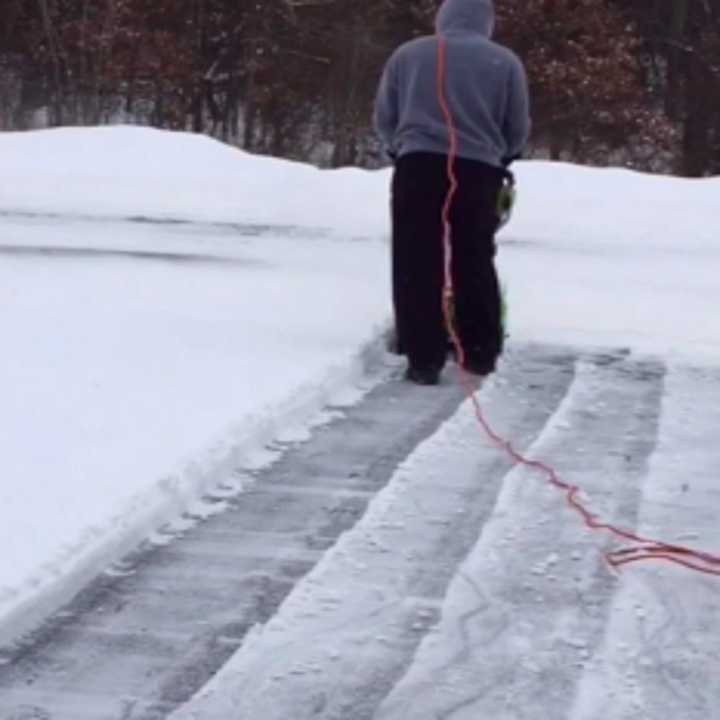 Same reviewer from a different angle, showing clean rows of removed snow