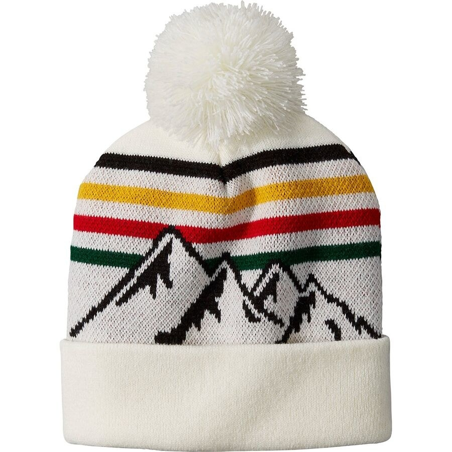 white beanie with a white pom on top with the pendleton stripes and a mountain range