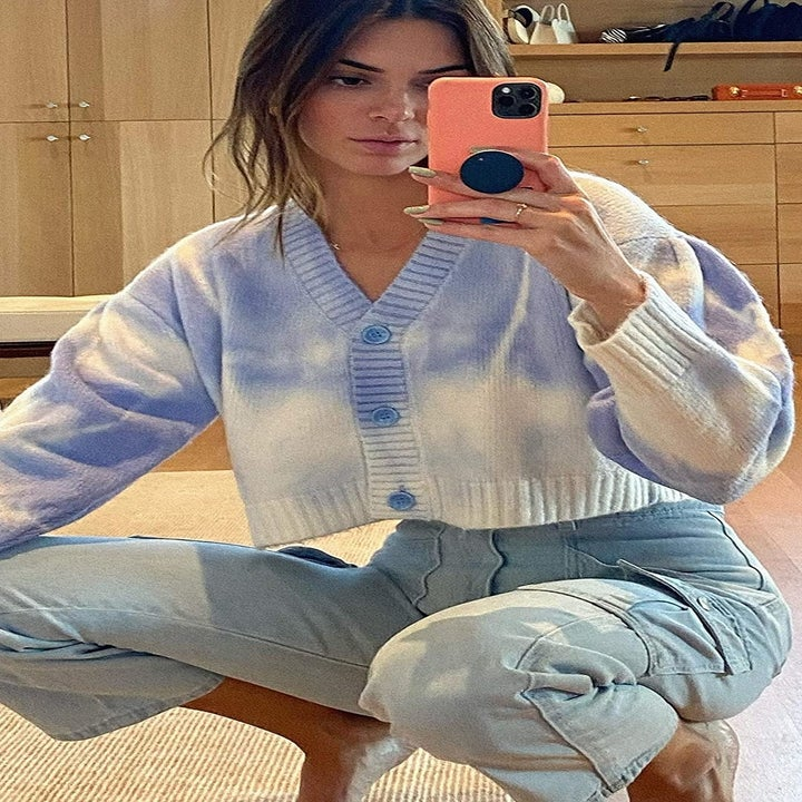 Kendall Jenner in cropped knit cardigan with sky blue buttons and white and blue pattern